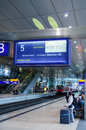 Vintage train information boarding board germany frankfurt september at frankfurt airport station with people commuting on Royalty Free Stock Photo