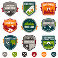 Vintage travel and camp badges set of woods emblems Stock Photos
