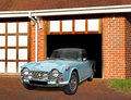 Vintage triumph tr4 sports car in garage Royalty Free Stock Photo