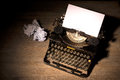 Vintage typewriter and a blank sheet of paper Royalty Free Stock Photo