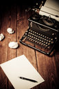 Vintage typewriter and a blank sheet of paper retouching retro Royalty Free Stock Images