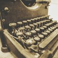 Vintage typewriter close up in sepia tone with old fashioned keys black Stock Image