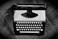 Vintage typewriter old on wooden background high contrast black and white photo Stock Image