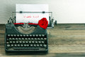 Vintage typewriter with paper page and rose flower white red sample text thank you Stock Image