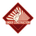 Vintage under construction looking sign which can be used for websites and web development Royalty Free Stock Photos