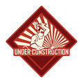Vintage under construction looking sign which can be used for websites and web development Stock Photo