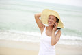 Vintage vacation woman use smart phone young fit asian taking photo seaside Royalty Free Stock Image
