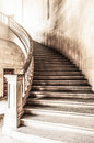 Vintage view of marble spiral staircase. Royalty Free Stock Photo