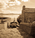 Vintage view of stromness traditional house with a to the sea orkney Royalty Free Stock Photos