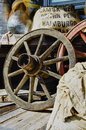 Vintage wagon wheel and old stuff in background retro Royalty Free Stock Photography