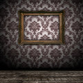 Vintage wall background with empty gold frame Royalty Free Stock Photo