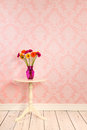 Vintage wall and wooden floor with vase flowers on table plinth white Royalty Free Stock Photo