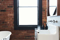 Vintage warehouse bathroom conversion with large blank window fo Royalty Free Stock Photo