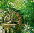 Vintage water mill wheel running Royalty Free Stock Photo