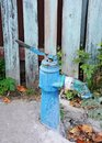 Vintage water pump old above concrete trough Royalty Free Stock Photography