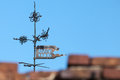 Vintage weather vane in tallinn above blue sky Stock Photo