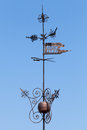 Vintage weather vane in tallinn above blue sky top of old fortress tower estonia Stock Photos