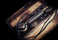 Vintage weathered military telephone from wwii period toned photo with filter effect Stock Images