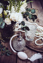Vintage wedding decor, perfume and pearl beads, flower bouquet Royalty Free Stock Photo