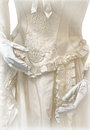 Vintage wedding dress embellished with ornaments and embroidery Royalty Free Stock Photo
