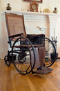 Vintage wheel chair a from the early th century era made of wood and steel Royalty Free Stock Image