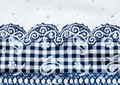 Vintage white and blue cotton fabric with floral checked pattern Royalty Free Stock Photos