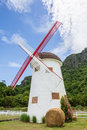 Vintage windmill with straw bales Royalty Free Stock Photo