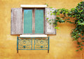 Vintage window on yellow cement wall Royalty Free Stock Image