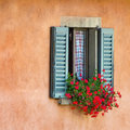 Vintage windows with open wooden shutters and fresh flowers Stock Photos