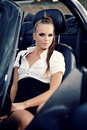 Vintage woman with cabrio car Royalty Free Stock Photos