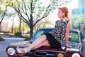 Vintage woman on Muscle Car Royalty Free Stock Photography