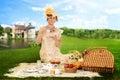 Vintage woman picnic by lake Royalty Free Stock Photo