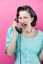 Vintage woman shouting into telephone Royalty Free Stock Image