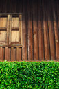 Vintage wood house with green leaf fence Royalty Free Stock Photo