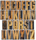 Vintage wood type alphabet complete english a collage of isolated letterpress printing blocks scratched and stained by ink Royalty Free Stock Photos