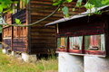 Vintage wooden apiary with beehives Royalty Free Stock Photo
