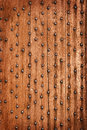 Vintage wooden background with metal rivets the gate of the old castle Stock Photography