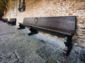 Vintage wooden bench in old church courtyard Stock Photos