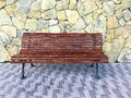 Vintage wooden bench on stone background Royalty Free Stock Photo