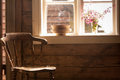 Vintage wooden chair, old cottage next to window Royalty Free Stock Photo