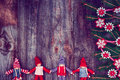 Vintage wooden Christmas background with rag dolls Royalty Free Stock Photo