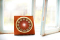 Vintage wooden clock on old rural window concept past time at the Stock Image