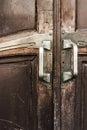 Vintage wooden doors with brass door knobs textured Royalty Free Stock Image