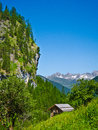 Vintage wooden house in the alps with panoramic mountains Royalty Free Stock Photography