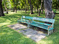Vintage wooden park bench at a Stock Photo