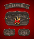 Vintage wooden restaurant signs set of with decor and golden cutlery Stock Photography
