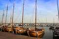 Vintage wooden sailboats docked in a Holland harbor Royalty Free Stock Photo