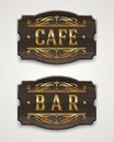 Vintage wooden signs for cafe and bar with golden lettering decorative elements Stock Photography