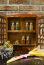Vintage Wooden Spice Rack or Storage Cabinet and six glass bottl Royalty Free Stock Photo