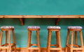 Vintage wooden stool chair on green background Royalty Free Stock Photo